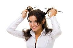 La donna rotea i suoi capelli con i bastoni Fotografie Stock Libere da Diritti
