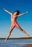La donna salta su Immagine Stock Libera da Diritti