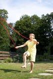 La donna senior attiva è corda di salto Immagine Stock Libera da Diritti