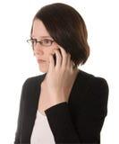 La donna seria comunica sul telefono Fotografia Stock Libera da Diritti