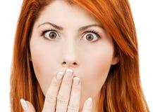 La donna stupita con consegna la bocca Fotografia Stock Libera da Diritti