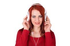 La donna sveglia ascolta musica sopra il bianco Immagini Stock Libere da Diritti