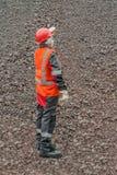 La donna in vestiti da lavoro protettivi protezione di lavoro Immagini Stock