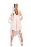 La donna in vestito elegante indietro osserva Fotografie Stock Libere da Diritti