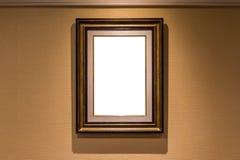 La ejecución de lujo en blanco del marco de la foto en el interior marrón de la pared Foto de archivo