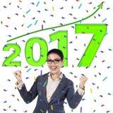 La empresaria está celebrando su éxito en 2017 Foto de archivo libre de regalías
