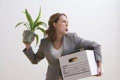 La empresaria hace una cara tonta Imágenes de archivo libres de regalías