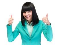 La empresaria que muestra los pulgares sube la muestra de la mano Mujer de negocios caucásica acertada y hermosa aislada en blanc Imagen de archivo libre de regalías