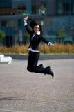 La empresaria salta al aire libre Foto de archivo libre de regalías