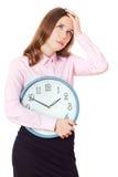 La empresaria se está sosteniendo en reloj de las manos Fotografía de archivo