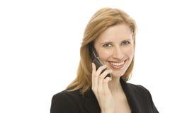La empresaria utiliza el teléfono celular Imágenes de archivo libres de regalías