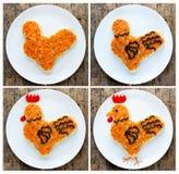 La ensalada festiva formó símbolo del gallo o del gallo del Año Nuevo 2017 encendido Fotos de archivo libres de regalías