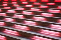 La escalera con la luz roja en ella Foto de archivo libre de regalías