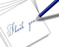 La escritura de la pluma le agradece en el papel Imagen de archivo libre de regalías
