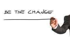 La escritura del hombre de negocios sea el cambio Imagen de archivo