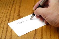 La escritura le agradece cardar Imagen de archivo libre de regalías