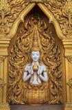 La escultura de la deidad en la pared Fotos de archivo libres de regalías