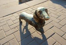 La escultura del metal del perro fotos de archivo