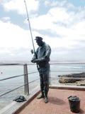 La estatua conmemorativa falleció Las Palmas Gran amarillo magnífico de los pescadores Imagenes de archivo