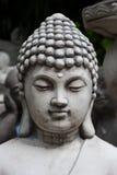 La estatua de la cara del yeso de Buda aisló en el fondo blanco Fotografía de archivo libre de regalías