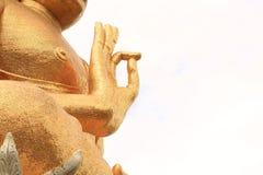 La estatua de oro de Buda de la derecha de la mano del primer de la pierna del lugar en blanco es Foto de archivo