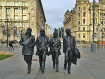La estatua del Beatles, Liverpool imagenes de archivo