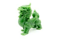 La estatua del león el símbolo de potente en aislante chino de la creencia Imagenes de archivo