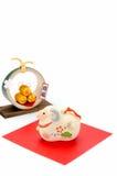 La estatuilla del arroz de oro de las ovejas y de la paja tres empaqueta Fotografía de archivo libre de regalías
