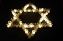 La estrella de David hizo con las velas Fotografía de archivo libre de regalías