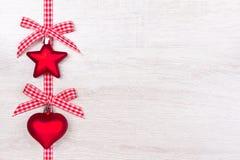 La estrella del corazón de la Navidad arquea rojo Foto de archivo
