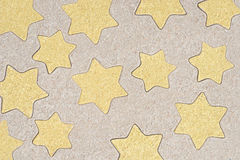 La estrella forma el dibujo del modelo en arena Fotografía de archivo