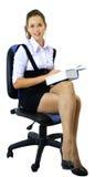 La estudiante se sienta en la silla Imágenes de archivo libres de regalías
