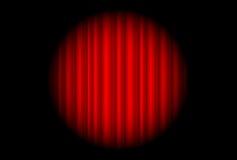 La etapa con la cortina roja y el punto grande se encienden Fotos de archivo