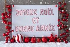 La etiqueta, copos de nieve, bolas de la Navidad, Bonne Annee significa Año Nuevo Fotos de archivo