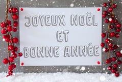 La etiqueta, copos de nieve, decoración de la Navidad, Bonne Annee significa Año Nuevo Fotos de archivo