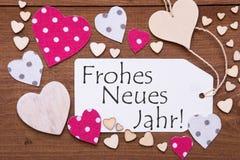 La etiqueta, corazones rosados, Frohes Neues Jahr significa Feliz Año Nuevo Imagenes de archivo