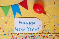 La etiqueta del partido, confeti, globo, manda un SMS a Feliz Año Nuevo Imagen de archivo