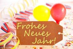 La etiqueta del partido, globo, flámula, Frohes Neues significa Feliz Año Nuevo Foto de archivo libre de regalías