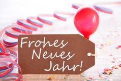 La etiqueta del partido, globo, Frohes Neue Jahr significa Feliz Año Nuevo Imagenes de archivo