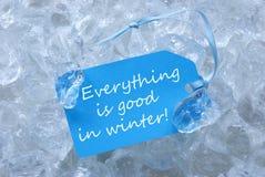 La etiqueta en el hielo con todo es buena en invierno Imágenes de archivo libres de regalías