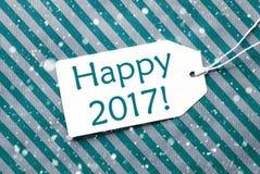 La etiqueta en el papel de la turquesa, copos de nieve, manda un SMS a 2017 feliz Imagen de archivo libre de regalías