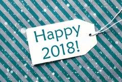 La etiqueta en el papel de la turquesa, copos de nieve, manda un SMS a 2018 feliz Imagen de archivo libre de regalías