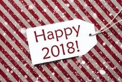 La etiqueta en el papel rojo, copos de nieve, manda un SMS a 2018 feliz Imagen de archivo