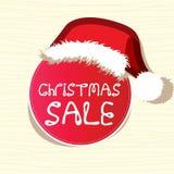 La etiqueta engomada de la venta desgasta un sombrero de la Navidad Fotografía de archivo