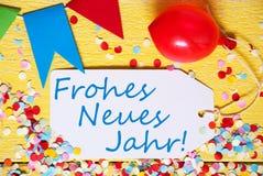 La etiqueta, globo rojo, Frohes Neues Jahr significa Feliz Año Nuevo Foto de archivo