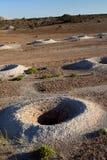 La explotación minera del ópalo agujerea II Imagen de archivo