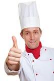 La explotación agrícola del cocinero del cocinero manosea con los dedos para arriba Foto de archivo libre de regalías