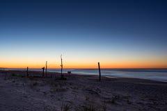 La exposición larga como el sol sube a través del Océano Atlántico Fotografía de archivo libre de regalías