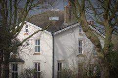 La facciata ad una casa di città georgiana tradizionale tipica al distretto di Bloomsbury di Londra centrale Fotografia Stock