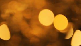 La falta de definición abstracta con el centelleo del partido brillante de Bokeh enciende el fondo abstracto Defocused del brillo metrajes